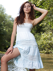 Fresh as well cold water in untouched nature offer specific taste of the forbidden fruit of sensuality. Sexy brunette cooling hot body.