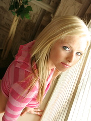Petite teen babe Skye teases with her perky tits as she lifts her pink striped shirt