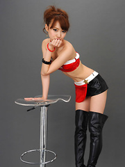 Ari Takada Asian in red black latex and long boots is so erotic