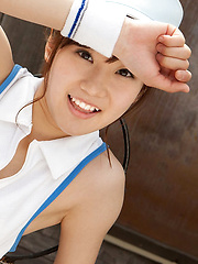 Kana Yuuki Asian shows flexibility while playing with tennis ball