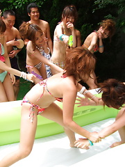 Slim Asian honeys love outdoor oil wrestling