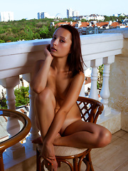The cold breeze rushes through her pink pussy as she spreads those long legs on the balcony for you to see.