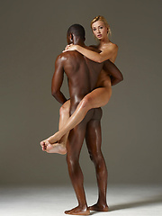Two oiled in softcore interracial scene