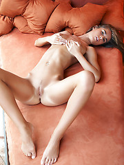 Large bulbous breasts adorn this super hot model with long luscious legs.