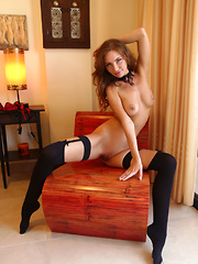 Galina A erotically strips on the couch baring her sexy, tight body.